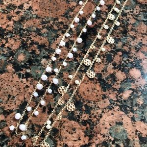 Two layering gold necklaces